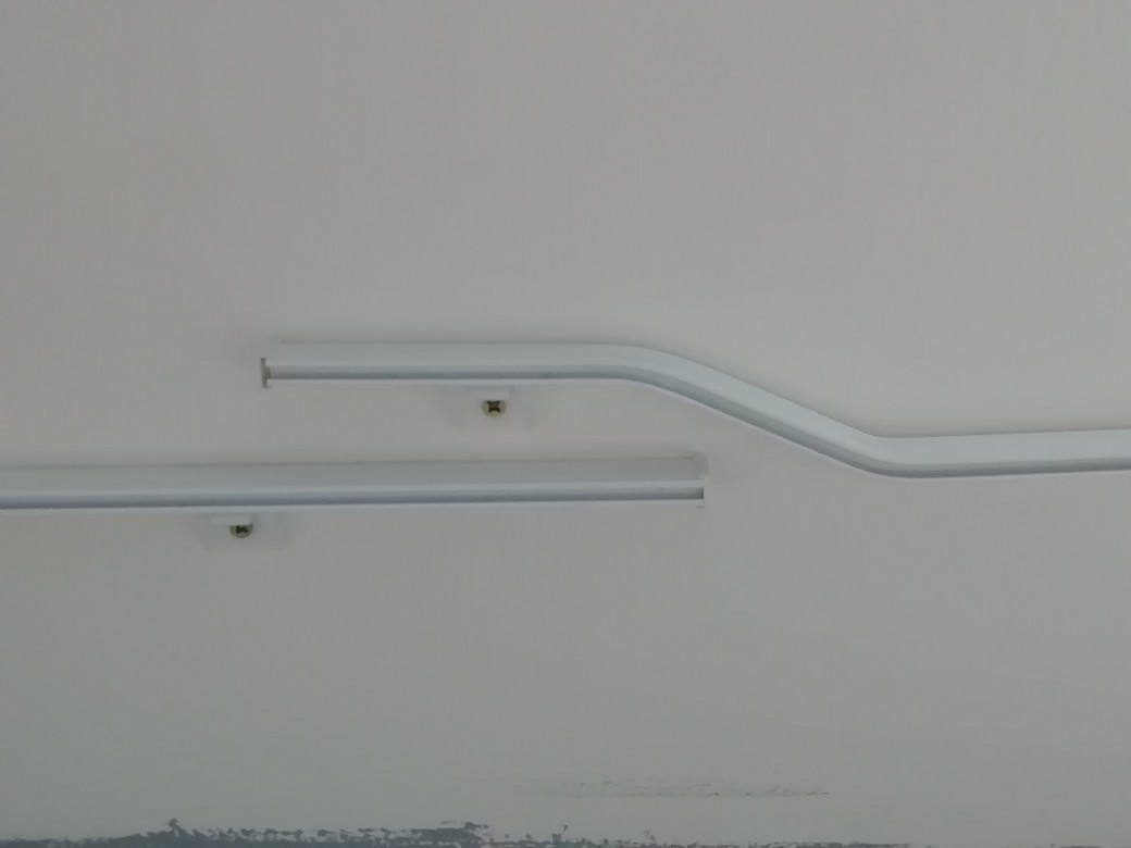 overlapping curtain tracks