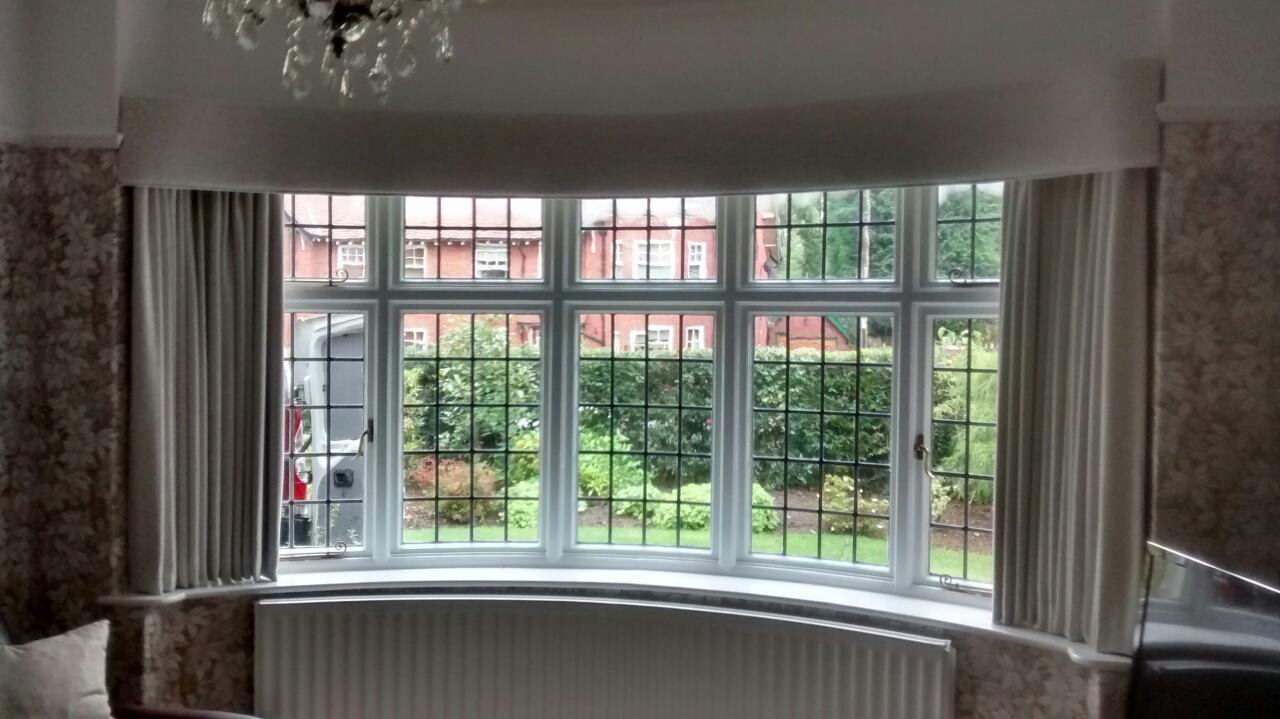 Curved bay window pelmet with simple lines for an understated look.