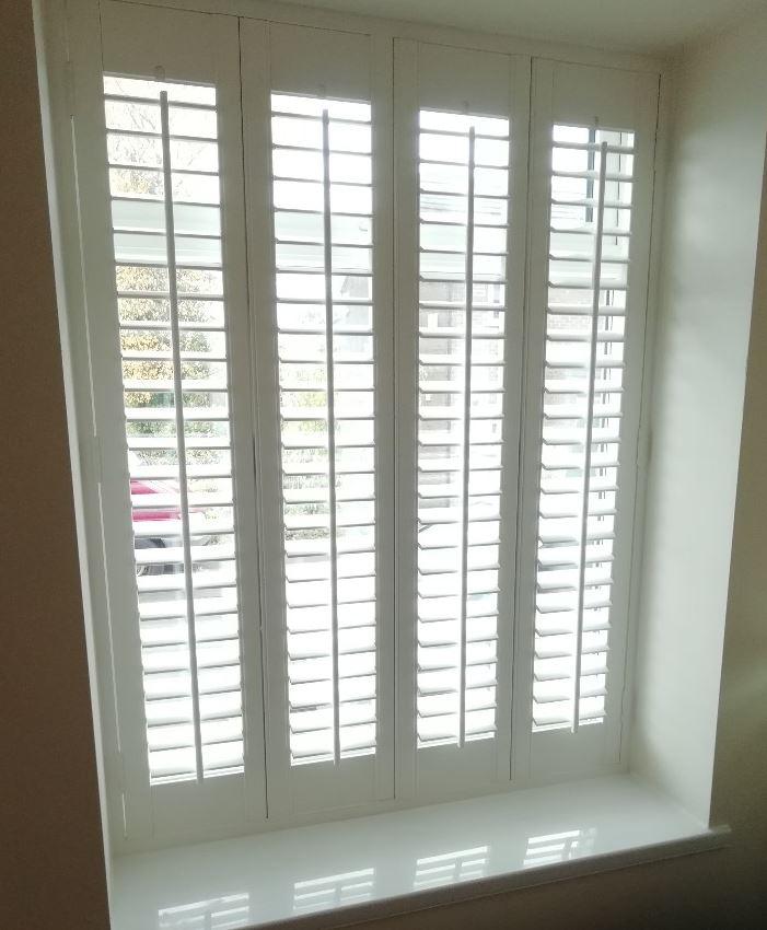 Bi fold plantation shutters