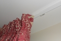 A really simple and neat fitting ceiling fitted curtain track.