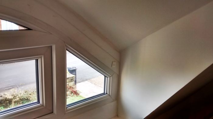 Bare and ugly dormer window before pelmet and curtains were installed