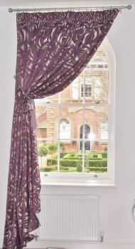 Single pencil pleat curtain draped in tie back