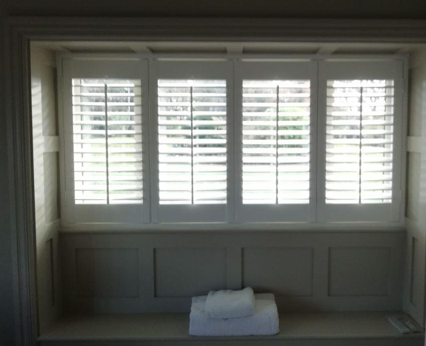 4 panel plantation shutters
