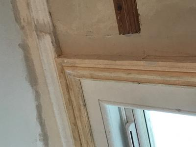 top of window frame where it meets ceiling