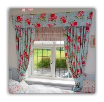 Stunning Fabric covered pelmet with matching curtains. Also a striped roman blind using the same vibrant colour pallete.