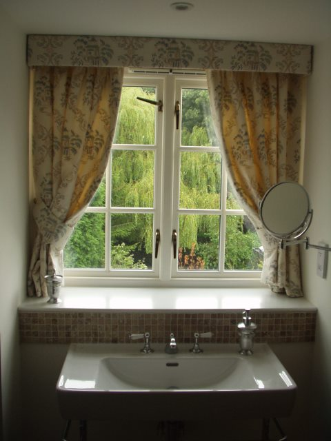 Simple bathroom curtain pelmet to dress this small window. Note how it does not really cover the window. So still allowing in lots of light.