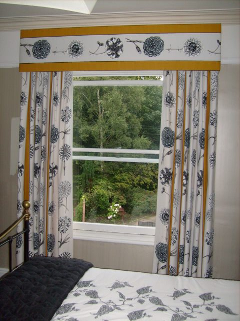 Bedroom curtain pelmet with the fabric running across. So allowing the full benefit of the fabric design. The matching curtains have the design running down the curtains.