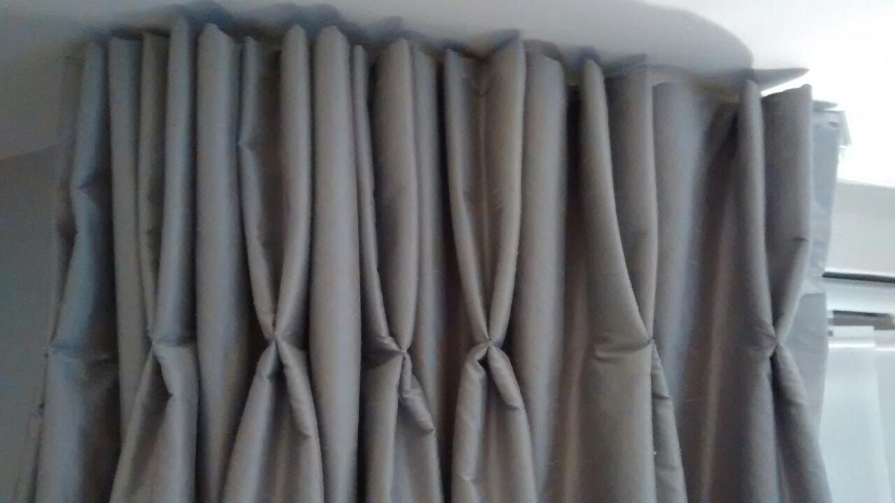 Pinch pleated blackout bedroom curtains.